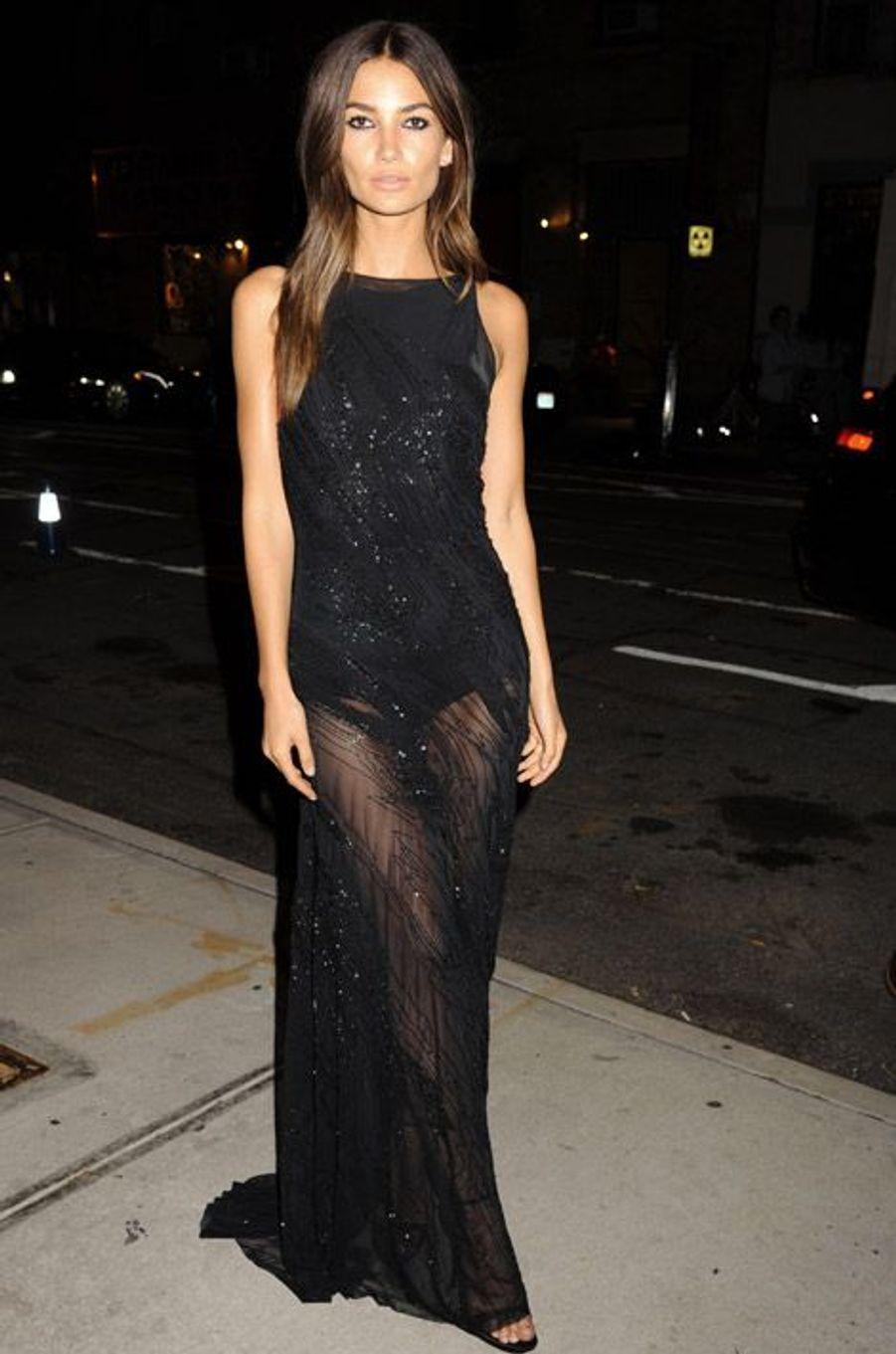 Le mannequin américain Lily Aldridge en Donna Karan, lors de la soirée organisée pour la sortie du livre Angels du photographe Russell James, le...