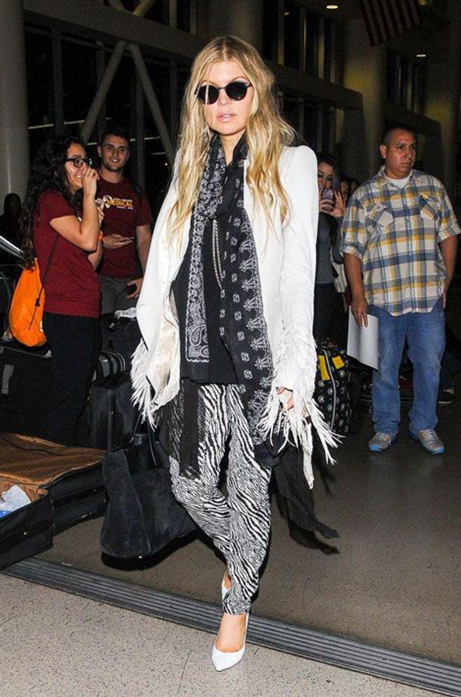 La chanteuse américaine Fergie à l'aéroport de Los Angeles, le 21 mars 2014