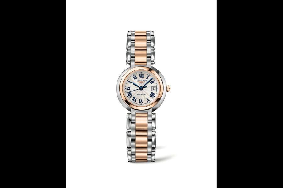 PrimaLuna en acier PVD or rose, 26, 5 mm de diamètre, cadran guilloché, mouvement automatique avec date, bracelet en acier et or rose. 2 800 euros, Longines.