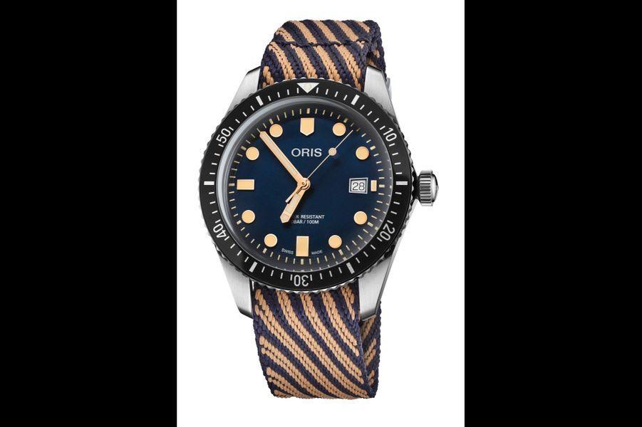 Divers Sixty-Five.Boîtier de 42 mm de diamètre en acier, bracelet fabriqué à 100 % à partir de plastique recyclé récupéré dans les océans, mouvement automatique.Oris.
