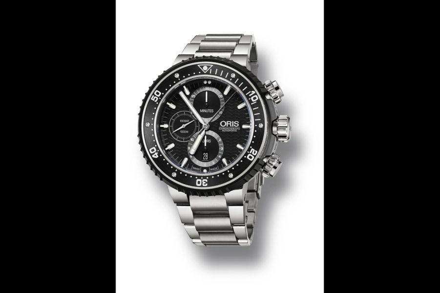 Chronographe Pro Diver en titane, lunette en céramique, 51mm de diamètre, mouvement automatique, bracelet en titane, étanche à 1 000 mètres. Oris. 4 350 €.