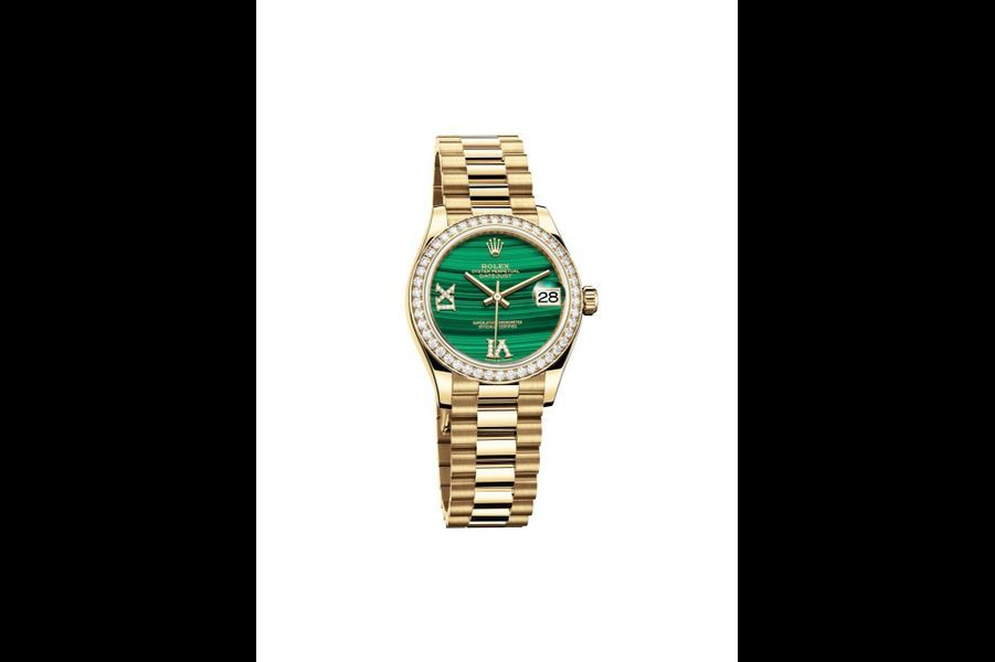 Datejust 31 en or jaune, lunette en diamants, 31 mm, cadran en malachite, mouvement automatique, bracelet en or jaune. Rolex. 40 450 €.