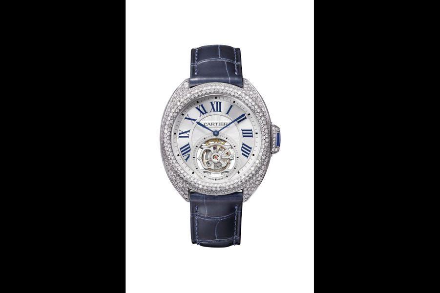Clé de Cartier en or gris et diamants, 35 mm de diamètre, mouvement à remontage manuel, bracelet en alligator. 153 000 €. Cartier.