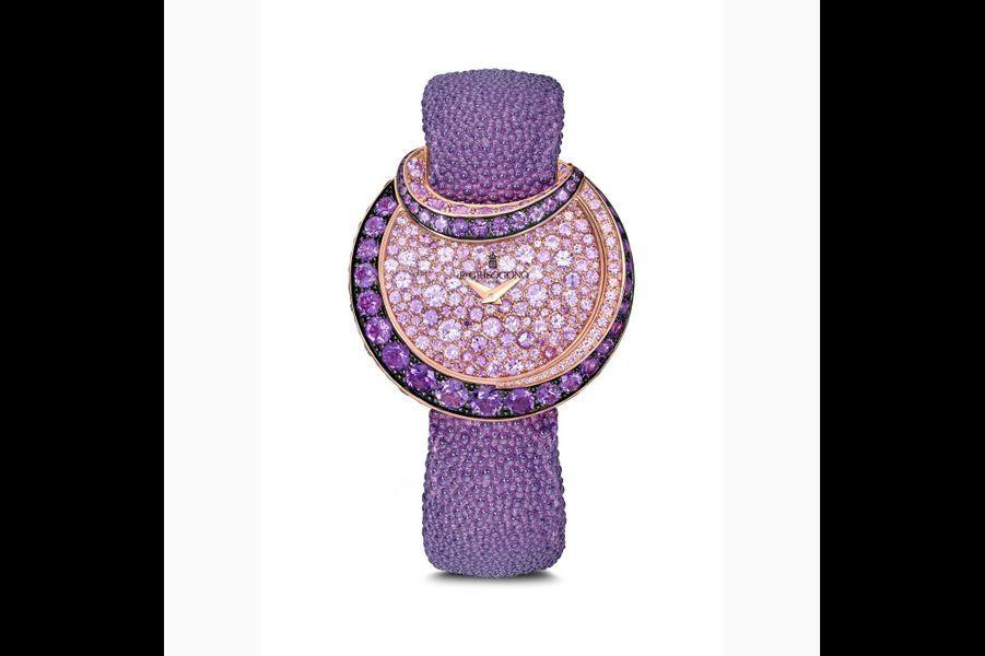 Luna en or rose sertie d'améthystes et de saphirs roses, mouvement à quartz, bracelet en galuchat. 58 100 €. De Grisogono.