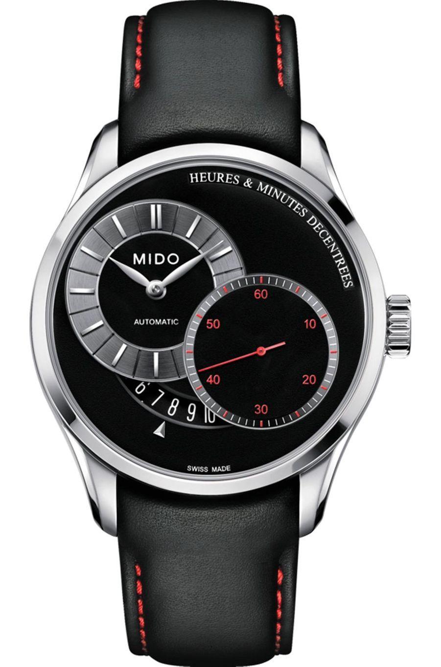 Belluna an acier, 40 mm de diamètre, mouvement automatique avec heures et minutes décentrées et grande seconde, bracelet en cuir. Mido, 1050 €.