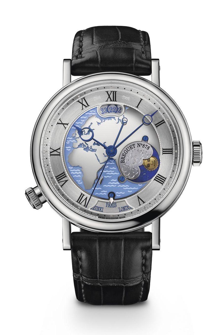Classique Hora Mundi 5717 en platine, 44 mm de diamètre, mouvement automatique avec second fuseau horaire instantané, indicateurs jour-nuit et des phases de lune, bracelet en alligator. Breguet, 91 800 €.