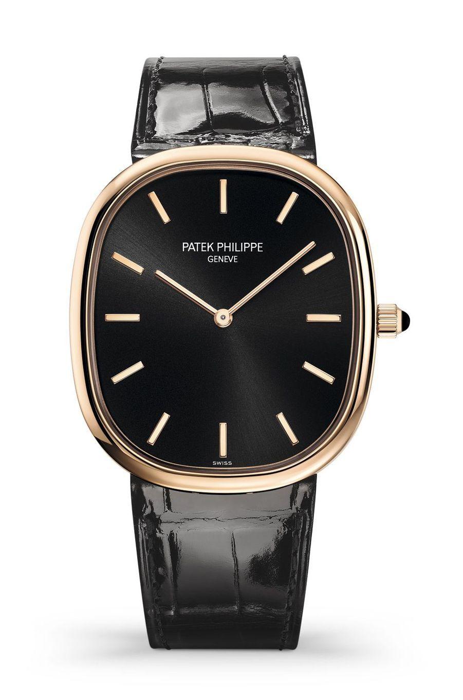 Ellipse d'Or en or rose, cadran noir ébène « soleil », mouvement automatique, bracelet en alligator. Patek Philippe. 28 980 €.