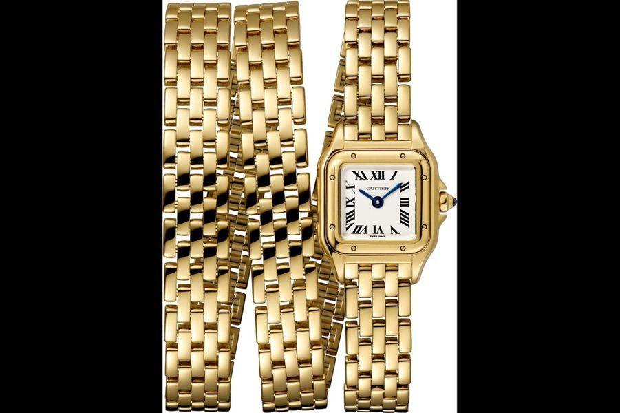 Panthère Mini Triple Tour en or jaune, cadran opalin, 20 mm x 25 mm, mouvement à quartz, bracelet en or jaune. Cartier. 34 800 €.