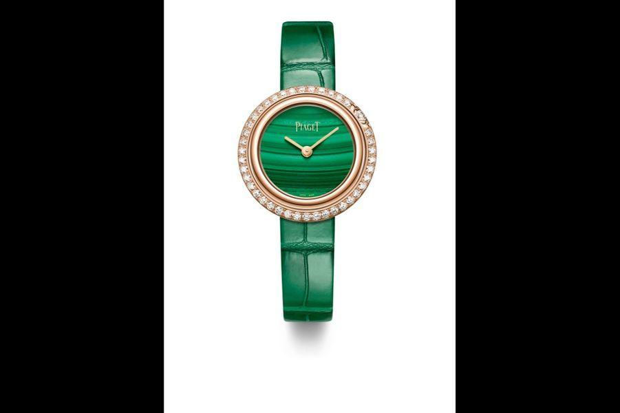 Possession en or rose, lunette sertie de diamants, 29 mm de diamètre, cadran en malachite, mouvement à quartz, bracelet interchangeable en alligator. Piaget. 17600 €.