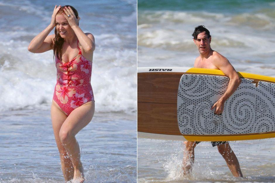 Isla Fisher et Sacha Baron Cohen, surf et détente à la plage