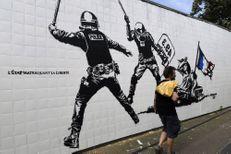 Cazeneuve scandalisé par une fresque jugée anti-police à Grenoble